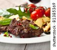 Rustic meat dish with grilled vegetables - stock photo