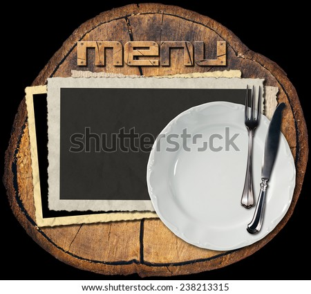 Rustic Menu Background. Section of tree trunk with empty photo frames, empty white plate with silver cutlery, written menu with wooden font. Background for a rustic menu - stock photo