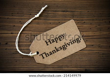 Rustic Natural Label with the Words Happy Thanksgiving on it on Wooden Background - stock photo