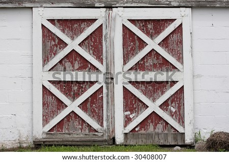 Rustic Old Red And White Barn Doors With Peeling Paint