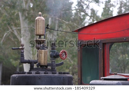 Rustic old train whistle on an industrial steam locomotive at a working museum  - stock photo