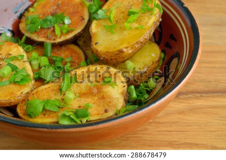 Rustic oven baked potatoes with herbs
