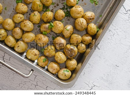 Rustic oven baked potatoes with parsley - stock photo