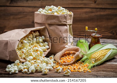 Rustic popcorn and corn - stock photo