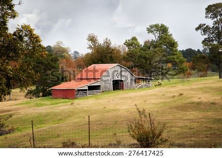 Rustic Red barn on an Autumn afternoon - stock photo