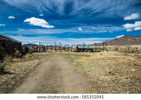 Rustic remnants of an abandoned ranch and big sky in Nevada's Great Basin region. - stock photo