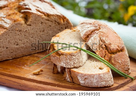 rustic rye bread on wooden board. Selective focus.