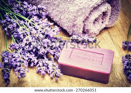 Rustic setting with natural soap and fresh lavender - stock photo