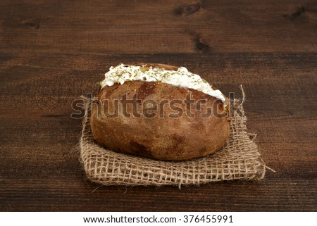 rustic sour cream and chive baked potato - stock photo