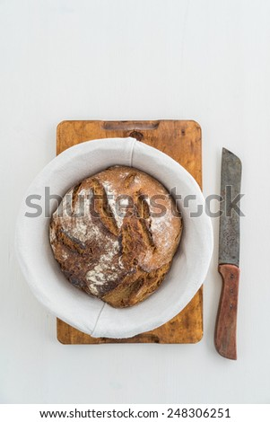 Rustic sourdough bread and knife - stock photo