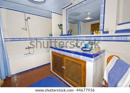 Rustic, Spanish country style, bathroom with white and blue decorated tiles.