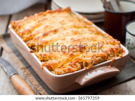 Rustic Style Cheese Crusted Crepe Bake on a Wodden Table - stock photo