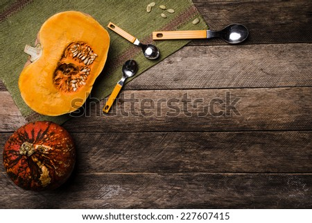 Rustic style pumpkins with seeds on green napkin and wood. Autumn Season food photo - stock photo