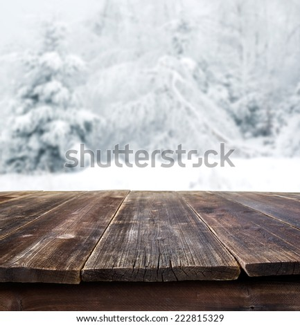 rustic table against winter landscape - stock photo