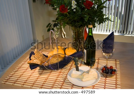 rustic table setting with cheese and red wine