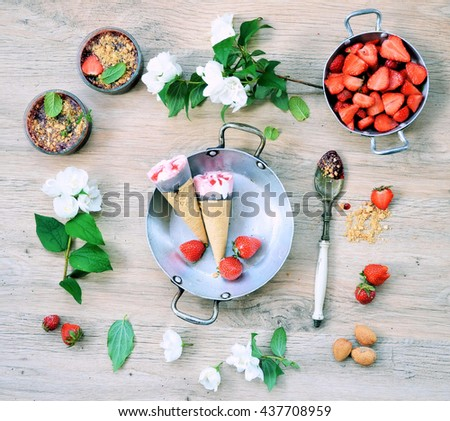 rustic table with dishes, summer desserts: ice cream,crumble , waffles and fresh berries , delicious organic concept ,rustic style from above  - stock photo
