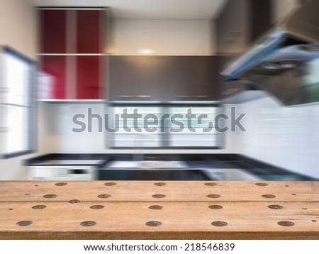 Rustic tabletop over modern kitchen blurry background - stock photo