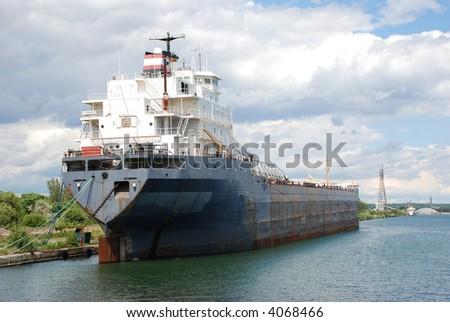 Rustic transport cargo ship - stock photo
