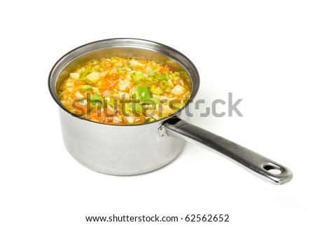 Rustic vegetable and ham broth in stainless steel saucepan isolated on white. - stock photo