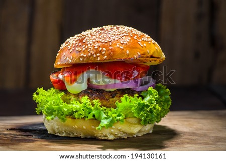 rustic view of a homemade burger - stock photo