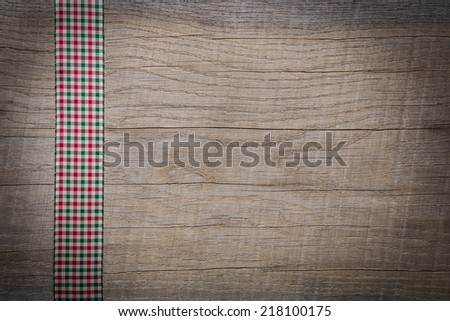 Rustic vintage country style wooden background with red bow for christmas. - stock photo