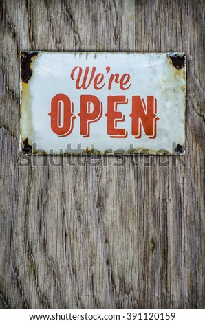Rustic Vintage Open Store Sign On A Wooden Door - stock photo