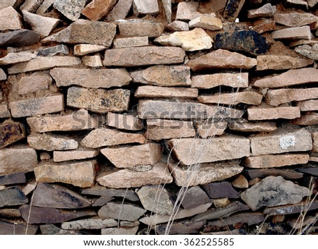 Rustic wall of sharp stones