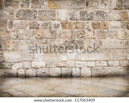 Rustic wall of stones of different sizes - stock photo