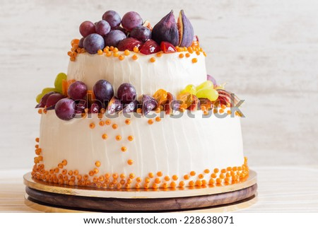 Rustic wedding cake with fruits - stock photo