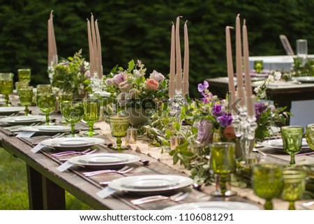Rustic wedding decor pink peach purple stock photo download now rustic wedding decor pink peach purple and green floral centerpieces on a wooden junglespirit Gallery