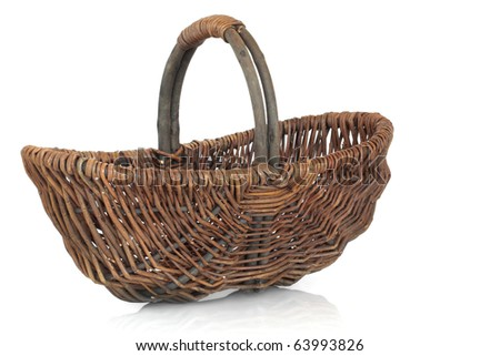 Rustic wicker shopping basket isolated over white background. - stock photo