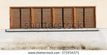 rustic window closed with wooden exterior shutters