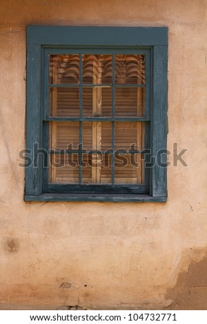 Rustic window with adobe style architecture - stock photo