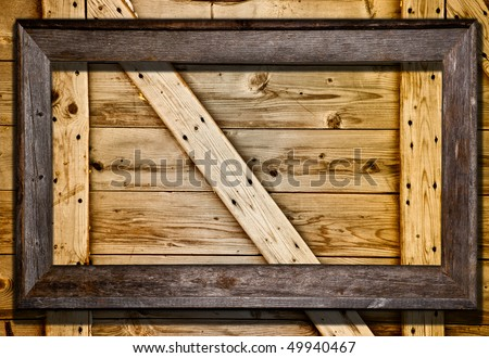 Rustic wood frame against barn door or wood panel background. Blank frame template for your text or image. - stock photo