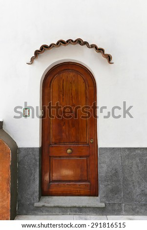 Rustic Wooden Arch Door at House in South Italy - stock photo