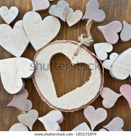 Rustic wooden background with various hearts