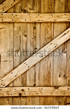 Rustic wooden barn door. - stock photo