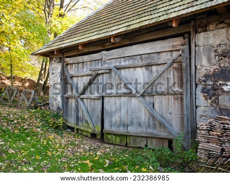 Rustic wooden barn gate of old aged barn - stock photo