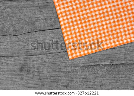 Rustic wooden boards with a orange checkered tablecloth - stock photo
