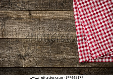 Rustic wooden boards with a red checkered tablecloth - stock photo