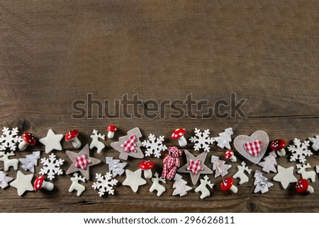 Rustic wooden christmas background with red and white checked country style decoration.