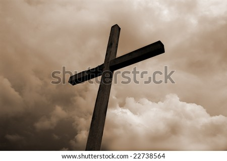 rustic wooden cross against dramatic sky - stock photo