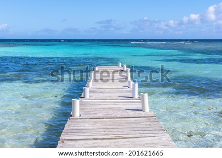 Rustic wooden dock at Playa Larga on beautiful Caribbean island of Culebra in Puerto Rico - stock photo