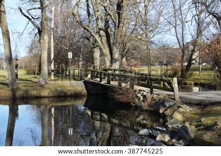 Rustic wooden made bridge across the duck pond at Virginia Tech, Blacksburg VA. - stock photo