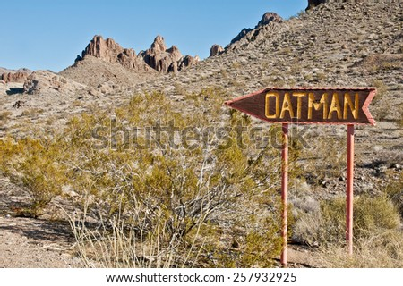 Rustic wooden sign directing travelers to Oatman, Arizona along historic Route 66