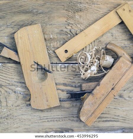 Rustic woodworking tools on old wooden table. Top view. copy space