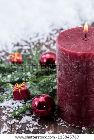 Rustical red Candles in the snow