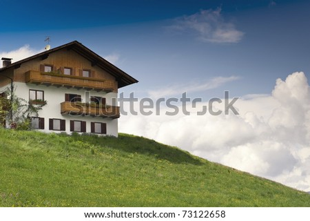 Rustical wooden House on a Hill in Tyrol, Austria - stock photo