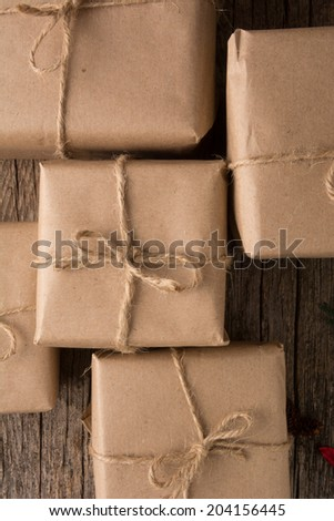Rustically wrapped Christmas gifts  with twine - stock photo