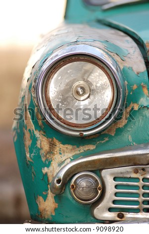 rusting car headlight - stock photo